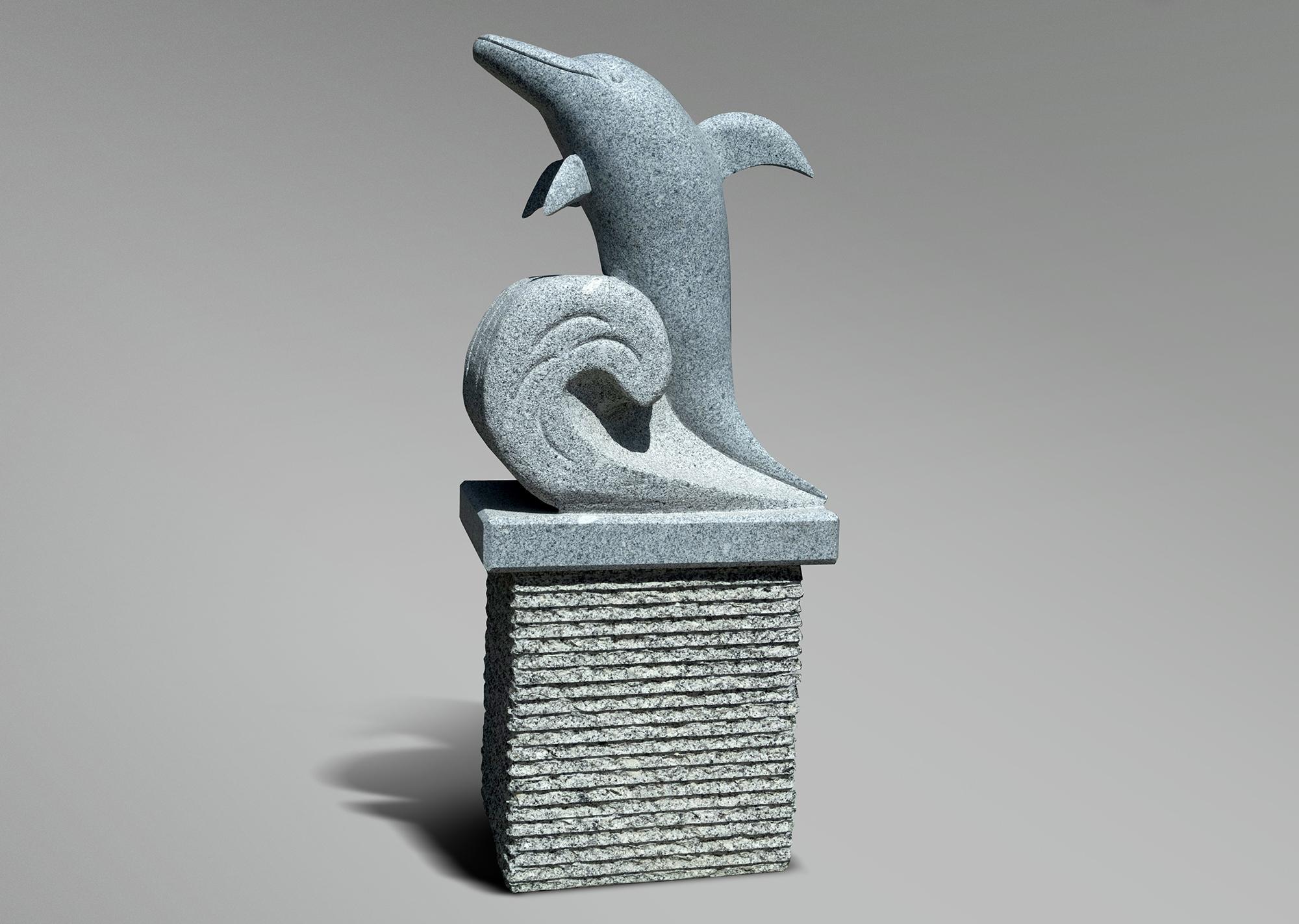 Delfín sobre pedestal